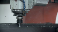 Drilling holes in slow motion Stock Footage