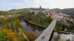 Autumn fall castle in Czech Republic river moat, bridge cars Stock Footage