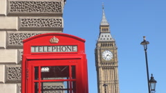 Red box vintage telephone famous London center Clock Tower sunny day landmark UK Stock Footage