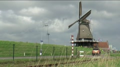 Windmill on the dike Stock Footage