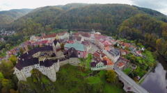 Aerial ancient castle shot, large moat lords residence, autumn Stock Footage