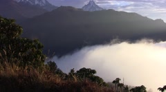 Thick clouds cover the ground in the Himalayas. Nepal. Stock Footage