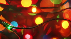 Colorful flashing christmas lights seamless loop close-up Stock Footage