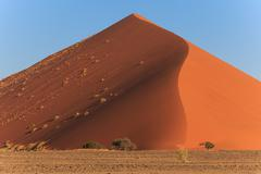mighty red dune of always shifting sand. sossusvlei, namibia, africa. - stock photo