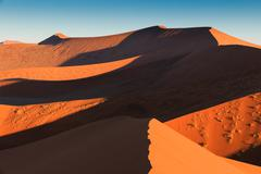 Walking to the end of red dune 45. sossusvlei, namibia, africa. Stock Photos