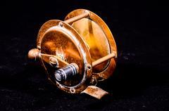 One vintage old metal fishing reel Stock Photos