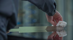 Worker is slowly and precisely cleaning metal part Stock Footage