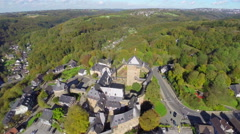 Old European village knights castle aerial, medieval walls town Stock Footage