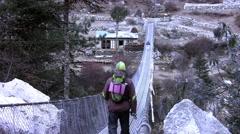 People passing the bridge over the Dudh Koshi river. Punki tenga vilage. Nepal Stock Footage