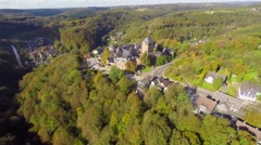 Ancient 600 year old castle in Germany Europe, aerial, village Stock Footage