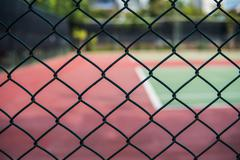 Fence of the tennis courts Stock Photos