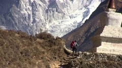 Stupa (buddhism) on the Ama dablam background. Nepal. Stock Footage
