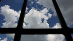 Prison bars and blue sky, dolly shot - stock footage