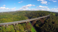 Unique high bridge 350 ft steam trains aerial, railroad junction Stock Footage