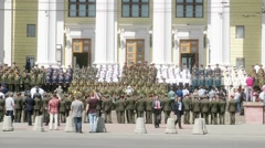 People in military uniforms are based near the Academic Theatre Stock Footage