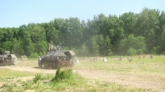 Soldiers riding on an armored vehicle during at Battlefield 2014 Stock Footage