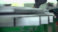 Screwing a screw in metal fetters Stock Footage