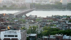 City ??buildings and bridge over River in Boston during sunset Stock Footage
