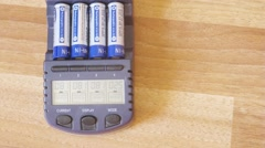 Batteries are charged in a special device, camera moves from the bottom up Stock Footage