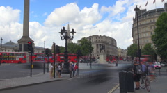 Timelapse red bus double decker Trafalgar Square Nelson Column London downtown  Stock Footage