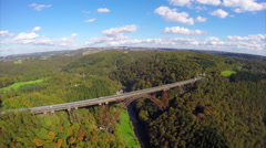 Old high steel bridge in Europe Germany, railroad train, aerial Stock Footage