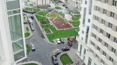 Playground and parking between buildings at new district Stock Footage