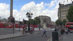 Traffic car street Trafalgar Square Nelson Column Crowded London city red bus UK Stock Footage