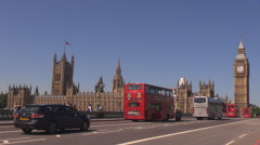 Traffic car street Westminster Bridge Clock Tower blue sky London center city UK Stock Footage