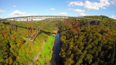 Flying under Mungstener Bridge huge steel construction aerial Stock Footage
