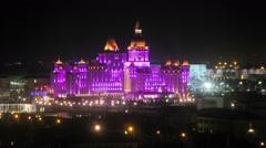 Illuminated Hotel Bogatyr on night sky background Stock Footage