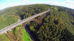 Old bridge constriction over valley river aerial shot Mungstener Stock Footage