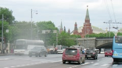 Cars driving past the Kremlin and then past the MSU building Stock Footage