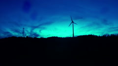 Spooky horror modern windmill establishing shot creepy blue tint Stock Footage