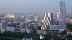 City landscape with multi-storey buildings at evening Stock Footage