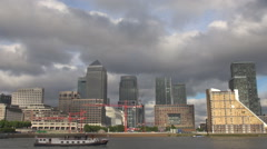 Panorama Canary Wharf ship cruise Thames river London financial district famous  Stock Footage