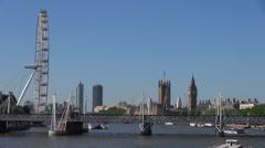 Timelapse London Eye Hungerford Bridge traffic Big Ben Tower Clock sunny day UK Stock Footage