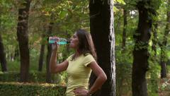 Woman having break and drinking, slow motion shot, steadycam shot Stock Footage