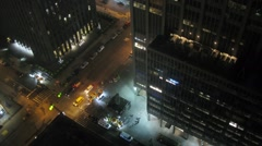 Top view of a crossroads near hotel at night, gradually brightens Stock Footage