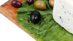 Roquefort cheese on wooden platter with olives Stock Footage