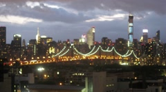 Queensboro Bridge and cityscape at evening, soft focus Stock Footage
