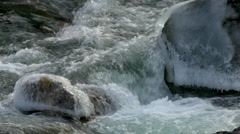 Stock video 4K flood ice on the freezing mountain river water Stock Footage