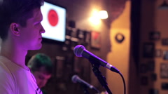The frontman sings on stage Stock Footage