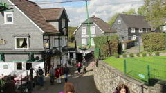 Old German town village, cable way up, houses, tourists walking Stock Footage