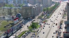 Citizens walk by pavement of New Arbat street with traffic Stock Footage