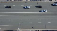 Transport traffic on two-way road at sunny day, view from above Stock Footage