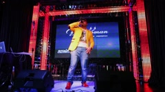 Stock Video Footage of Rapper in yellow jacket performs on stage in Dorffman club