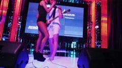 Singer Julia Kovaleva and Sergey Niedzwiecki with guitar sing Stock Footage