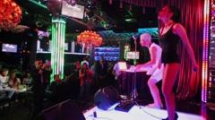 Julia Kovaleva dances on stage with guitarist Sergey Niedzwiecki Stock Footage