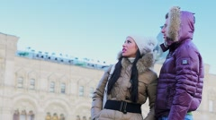 Couple talk and look around near edifice of GUM at Red square Stock Footage