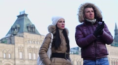 Couple talk, look around near edifice of Central Universal Store Stock Footage